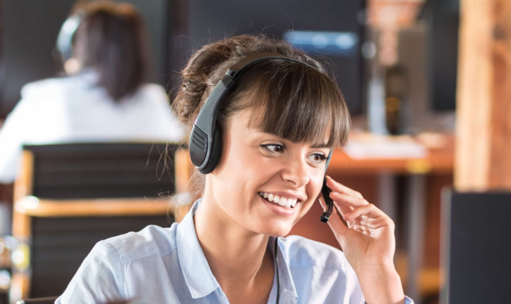 woman on headset talking to a customer