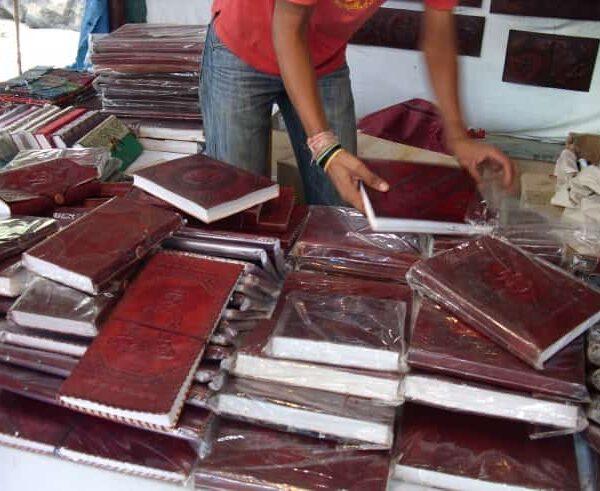 man stacking books