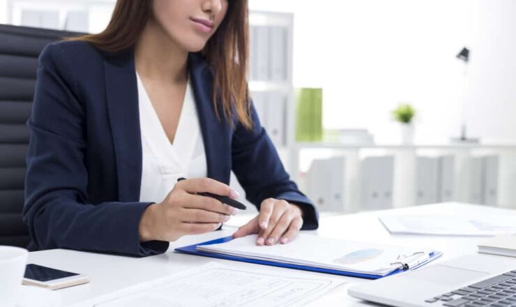 close up of woman working at her desk